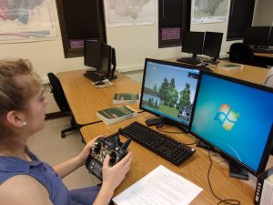 Student uses simulator to understand use of drones.