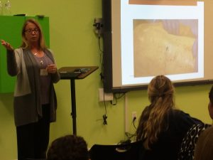 Sabrina Gast, a county coroner, talks to teens about forensics at a Teen Science Café.