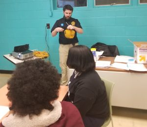 DNA Analyst, MacKenzie Kilkeary, talks to teens about his job.