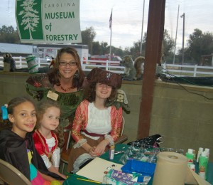 Mother Nature and her helpers at the face painting table.