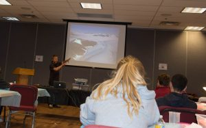 Dr. Jeremy Fyke talks to the teens about ice sheets.