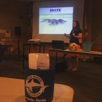 Presenter talks about manatee research that she works on.