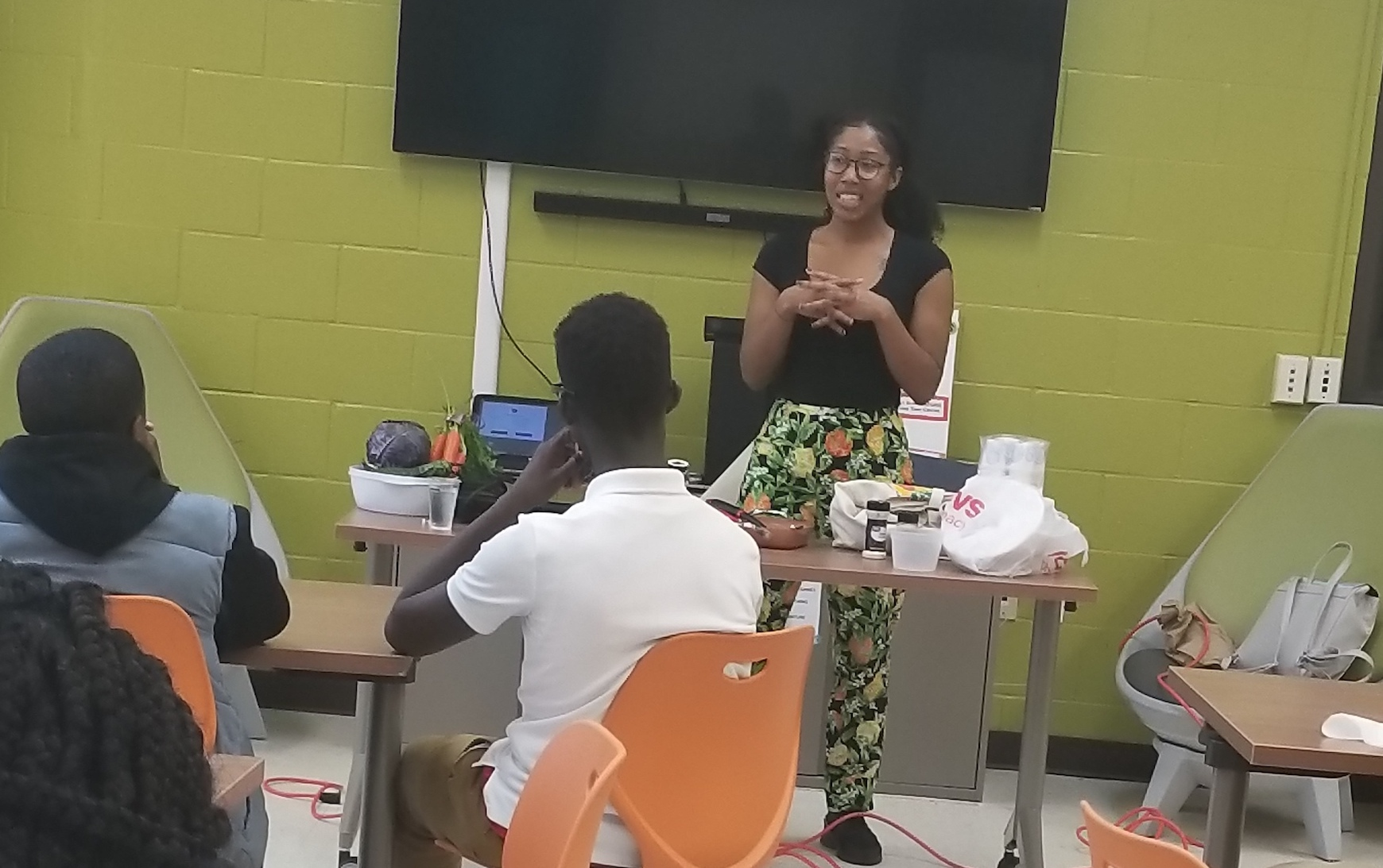 Speaker, Ms. Chaney, talks to kids about urban agriculture.