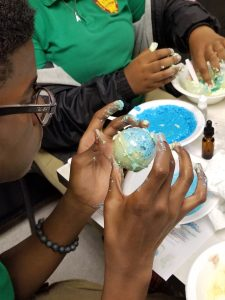 Teens making bath bombs
